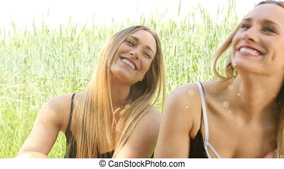 female twins having fun in the sun. dust and leaks. hd