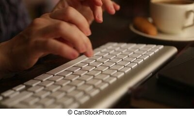 Female typing on computer keyboard. - Female office worker...