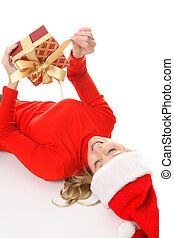 Female unties a Christmas present - Happy woman unties the...