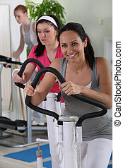 female using an exercise machine in the gym