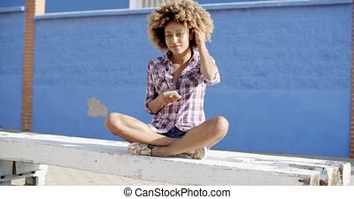 Female Using Mobile Phone On A Road