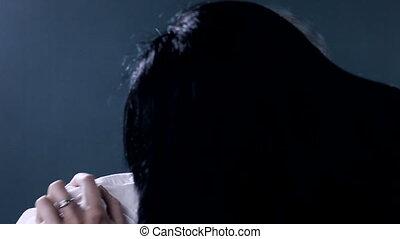 Woman vampire looking camera after killing man