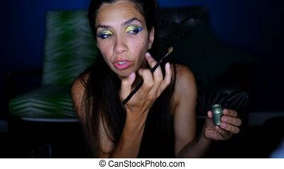 Female video blogger applying eyeshdow 4k - Female video...
