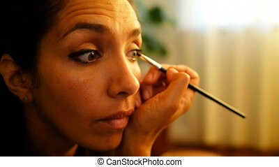 Female video blogger applying eyeshdow at home 4k - Close-up...
