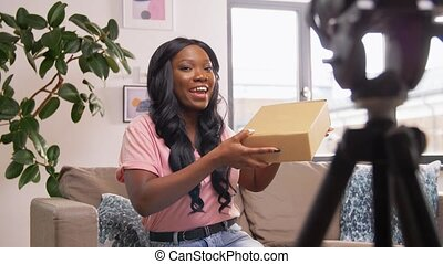 female video blogger opening parcel box at home - mail ...