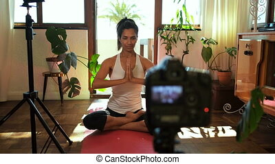 Female video blogger recording video about yoga 4k - Female...