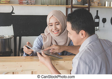 female waitress showing the menu to her customer