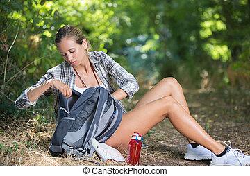 Female walker taking a break