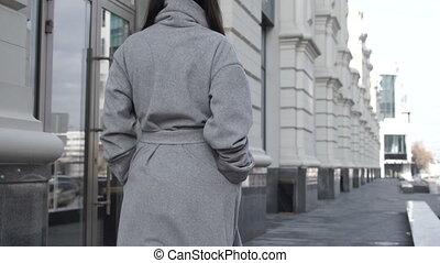 Female walking along city street