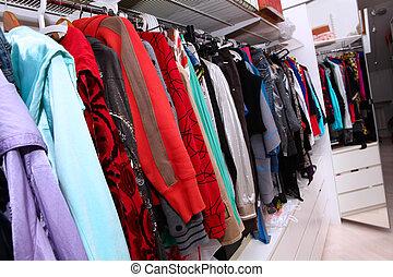 Female wardrobe - Home interior with female clothing hanging...