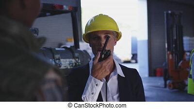 Female warehouse manager using radio 4k - Slow motion close ...