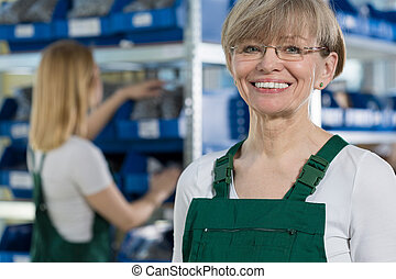 Female warehouse worker - Horizontal view of female...