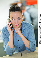 female warehouse worker on the phone