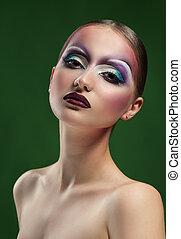 Female wearing art makeup studio shots