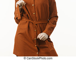 Female wearing casual brown dress