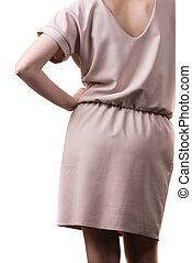 Female wearing casual pink tunic dress