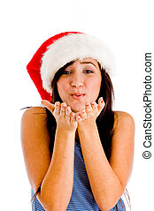 female wearing christmas hat and giving you flying kiss -...