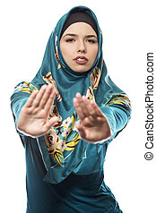 Female Wearing Hijab with Stop Gesture
