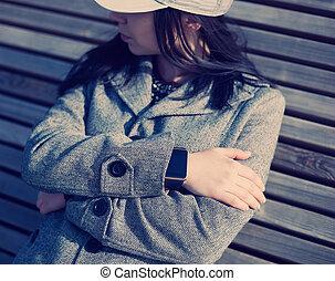Female wearing modern smart watch on her hand