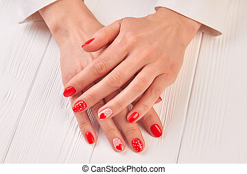 Female well-groomed manicured hands. Woman beautiful hands...