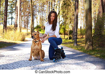 Female with brown dog.