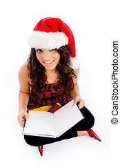 female with christmas hat and blank book