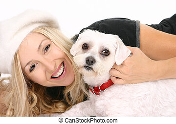 Female with dog - Cheerful female playing with a dog.
