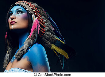 Female with Indian feather hat and colorful makeup. - Close...