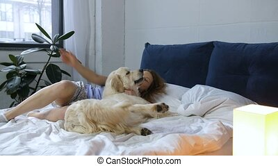 Female with retriever dog awaking in bedroom - Well rested...
