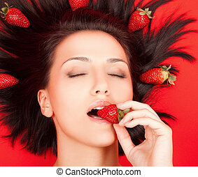 Female with strawberries