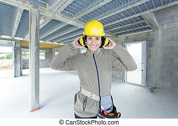 female worker at a construction site smiling