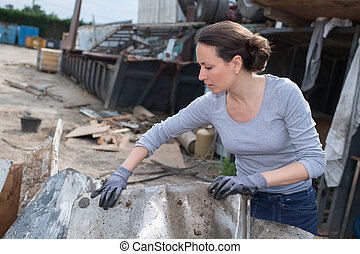 female worker at junkyard