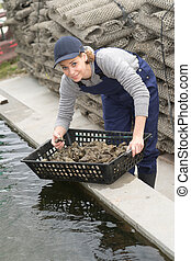 female worker at oyster farm