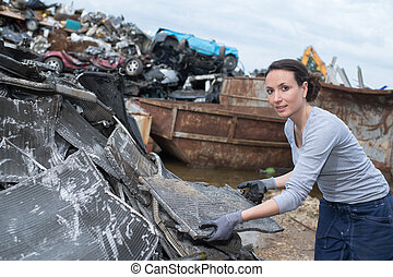 female worker at the junkyard