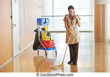 Female worker cleaning business hall - Female cleaner maid...
