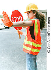 Female Worker Directs Traffic - Young female construction ...