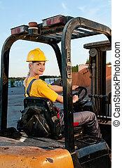 Female worker driving cargo truck