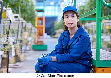 Female Worker on Break in Plantation