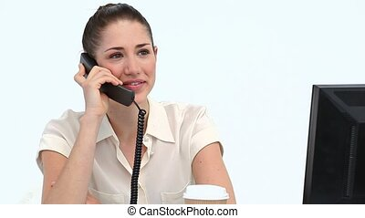 Female worker on the phone at her desk