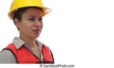 Female Worker Passing a Screwdriver - A smiling female...
