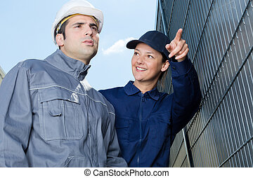female worker showing something to her colleague