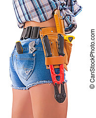Female worker. Tools in back pockets and tool belt. Close up.
