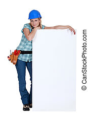 Female worker with a blank board
