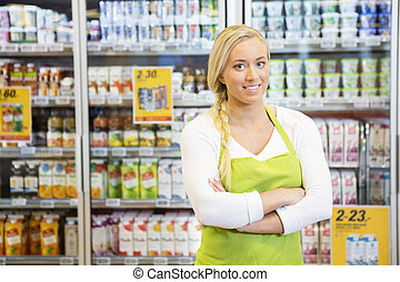 Female Worker With Arms Crossed In Grocery Store - Portrait ...