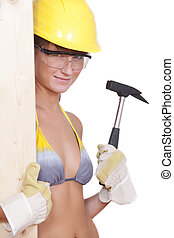 female worker with hammer