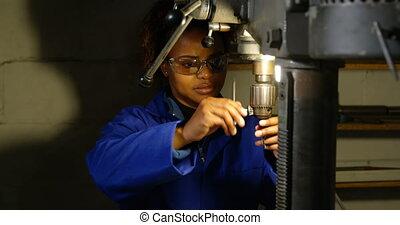 Female worker working in glass factory. Attentive female worker 4k