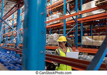 Female worker working in warehouse
