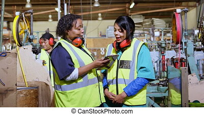 Female workers using digital tablet 4k - Female workers ...
