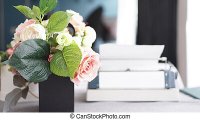 Female workspace with flowers bouquet on white background. Womens office desk