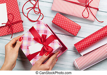 Female wrapping christmas gifts